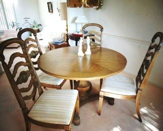 Inlaid oak pedestal table for your dining room with 4 ladder back chair (by Drexel)