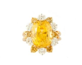 12 Carat Golden Sapphire. Set in 18 carat gold and platinum. Size 6. Payment must be made by cash, check, certified check, money order, or wire transfer. Non-US purchasers must make payment by wire transfer