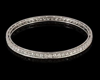 8 Carat Tiffany & Co. Platinum Bangle Bracelet. Bead set all the way around with a total of sixty six old European cut diamonds which measure approximate mounted total weight - 8.00 cts. Average mounted diameter - 3.15 mm. General cut and finish - good to very good for this age/style. Average mounted clarity - the vast majority are VVS with very few at VS-1. Estimated average mounted color - F-G. The bracelet is 4.3 mm wide and it weighs 24.6 grams. The outside diameter measures 2.85 inches. Payment must be made by cash, check, certified check, money order, or wire transfer. Non-US purchasers must make payment by wire transfer.
