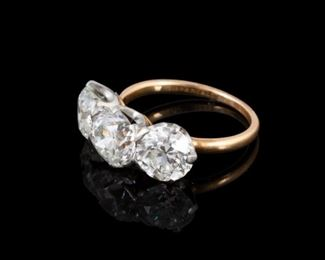 Tiffany & Co. 18kt Gold & Diamond Ring. Each setting has one old European cut diamond. The center diamond measures approximately mounted weight 1.62 cts., average mounted diameter - 7.40 mm, mounted depth - 4.71 mm, table - 3.9 mm, culet - slightly large, general cut and finish - good to very good, mounted clarity - VVS-2, estimated mounted color - H (no fluorescence). One of the two side diamonds (on the side with the Tiffany stamp) measures: approximate mounted weight - 1.33 cts., average mounted diameter - 7.07 mm, mounted depth - 4.25 mm, table - 4.1 mm, culet - slightly large, general cut and finish - good, mounted clarity - VVS-1, estimated mounted color - I-J (no fluorescence). One side diamond measures: approximate mounted weight - 1.32 cts., average mounted diameter 6.98 mm, mounted depth - 4.28 mm, table - 4.0 mm, culet - large, general cut and finish - good to very good, mounted clarity - VVS-2, estimated mounted color - (no fluorescence). The two side diamonds have minor ni