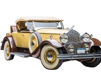 1931 Packard Model 840. Yellow with Brown Fenders, Six Wheel Rumble Seat Roadster with Brown Leather Interior. Overdrive added for drivability. Trippe driving lights, dual spot lights, dual welled fenders, hood ornament, window wings, luggage rack, trunk, trunk cover, golf door, and wide white wall tires on spoke wheels. The car achieved an AACA 2nd place National Award at York, Pennsylvania and an AACA 3rd place National Award as recently as 2007.