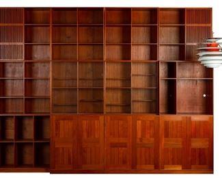 Mogens Koch (Danish, 1888-1993) Modular Bookcase. Designed, 1948. Executed by master cabinetmakers Rud. Rasmussen A/S, Copenhagen, Denmark, comprising three cabinets and nine shelving modules, teak, brass.