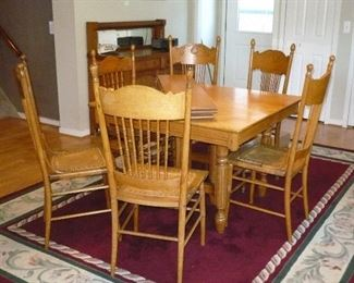Table has 4 leaf inserts and has 6 chairs