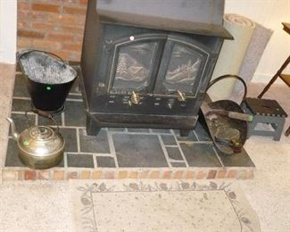 Wood Stove is NOT included in the sale. Only the items around it are for sale
