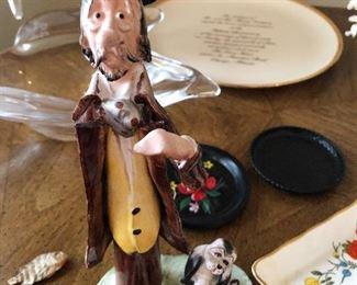 Porcelain man and dog signed by Caesar Poli