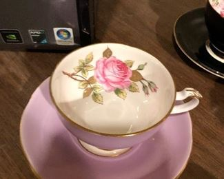 Adderley Floral and Figurine Tea cup and Saucer