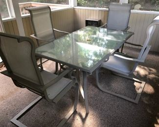 Dining  table and 4 chairs for patio. Purchased at JoPa.