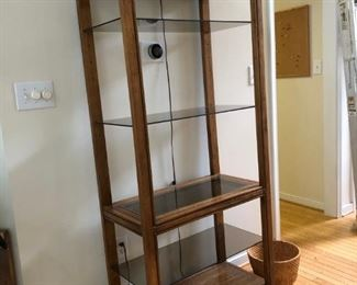 Glass Shelving with light.. Matches the console table.
