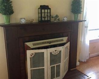 lovely décor...cute fireplace screen!