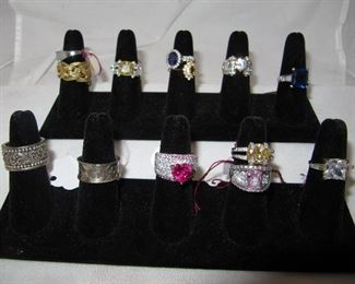 Sterling rings and two Lois Hill cigar band style rings
