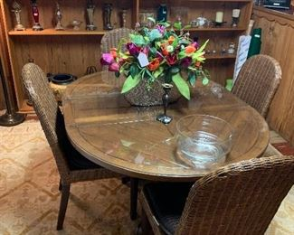 Lovely table and chairs. Top in great condition with glass cover.