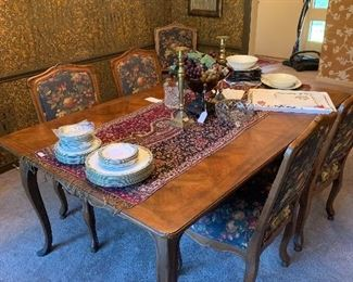 Exceptional dining room table and upholstered chairs