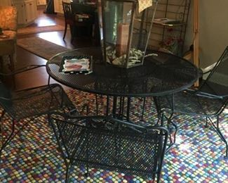 lovely 5 piece patio wrought iron set with arm chairs. Fun and festive Crate & Barrel wool rug in perfect condition.