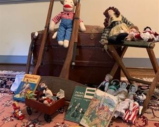 Old chest and assortment of old toys and dolls https://ctbids.com/#!/description/share/233756