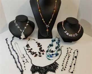 collection of costume jewelry necklaces and pair of earrings https://ctbids.com/#!/description/share/233771
