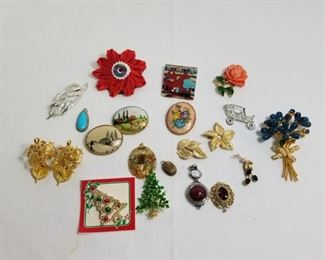 Collection of vintage costume jewelry pins and pendants https://ctbids.com/#!/description/share/233774