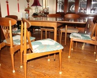 """Mid Century Modern drop leaf table and """"5"""" chair.  Wonderful early modern and unique design.  Look to be oak chairs."""