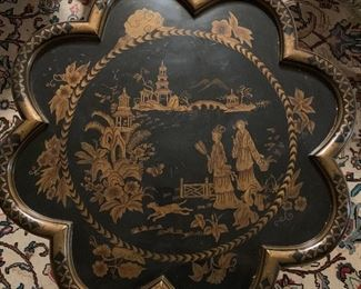 A close of the top of the chinoiserie table