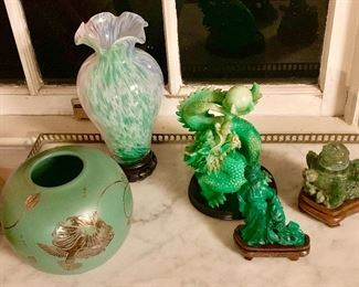 Here we have a collection of green! Contemporary green potoand art glass a carved glass dragon a malachite Chinese goddess and a small jade incense burning