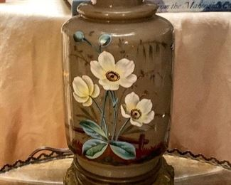 A small lamp purchased in Paris in 1980. The lamp is turn of the century
