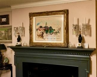 The mantel holds a pair of Napoleon Empire candlesticks circa 1830 pair of small Baccarat vases and a wonderful impressionistic painting by susan Dirk 1973.