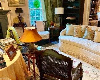Looking into the back half of the living room we see one one of the pair of  custom upholstered Baker loveseats along with French chairs, beautiful green silk draperies and much much more!
