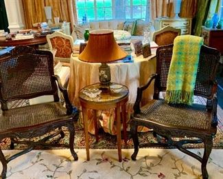 The pair of caned French Berger chairs.