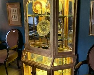 A beautiful gold display cabinet