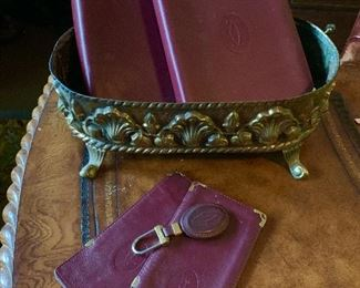 A collection of Cartier leather accessories