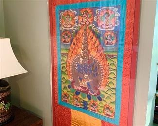 A silk Tibetan wall hanging purchased during their travels