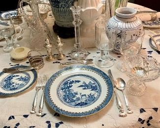 A closeup of a place setting at the table, the china is Booths Lowest Deer, the stemware is London by Orrefors  the sterling is Romance of the Sea by Wallace