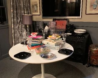 The den is filled with treasures from the ladies many trips to Asia. In the foreground we can see a Saarinen tulip table for Knoll filled with books on Bridge!