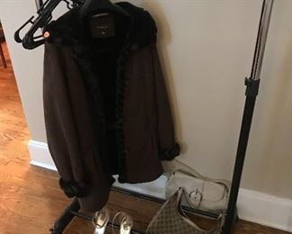 Garment Rack Coat  Coach Bag and Gucci Bag
