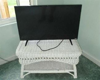 Wicker table and flat screen television