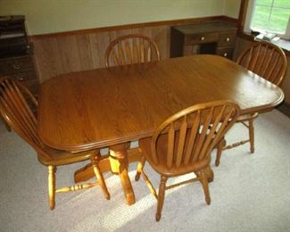 Oak dining room table and 6 chairs