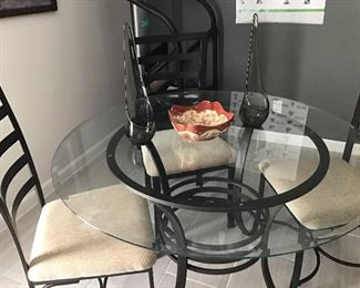 Glass Top Table on metal base with 4 metal chairs with upholsterd seats  $ 200 set