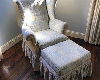 Custom collaged fabric skirted wingback with ottoman