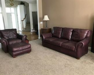 Quality leather sofa and matching chair with ottoman