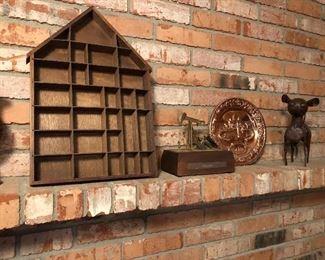 Shadow box, brass figurines, oil pump