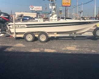 21 1/2 ft Hawk center console w/225 hp Merc, Magnum aluminum I beam trailer w/5 new tires, 4 new batteries, always lake ready and in great condition! Extras too numerous to mention.   Call Jim for appt to view
