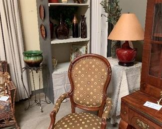 Assorted vases Victorian style upholstered  chair  Red lamp w shade Pottery Iron Plant stand