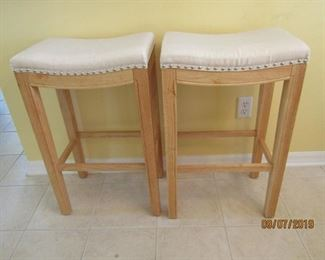 2 STOOLS FOR UNDER A COUNTER... NATURAL WOOD AND NATURAL COLOR FABRIC