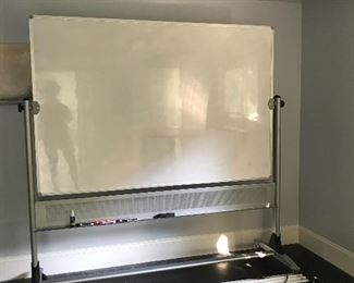 Two sided rolling white board in excellent condition, $150.  Originally $950.