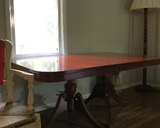Double claw foot mahogany dining table with two leaves, $110