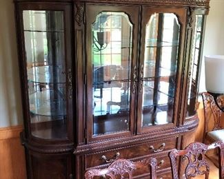 Striking Bernhardt china cabinet with curved and beveled glass.