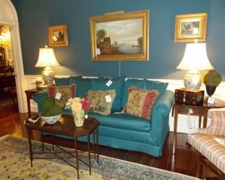 Beautiful Turquoise sofa, tapestry pillows, ginger jar lamps, tray table, florals, tea caddy