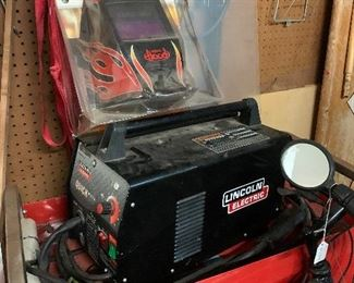 New Lincoln Electric Welder with Helmet.