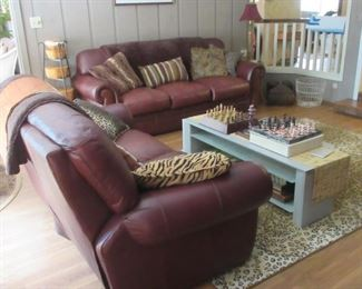 Brown leather sofa and double reclining loveseat with matching massaging recliner.  Pieces sold separately.