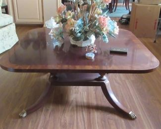 Vintage coffee table by prestigous maker with brass hooved feet.