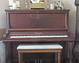 Antique Bauer upright piano.  In very good condition.  Fairly well tuned and just gorgeous!
